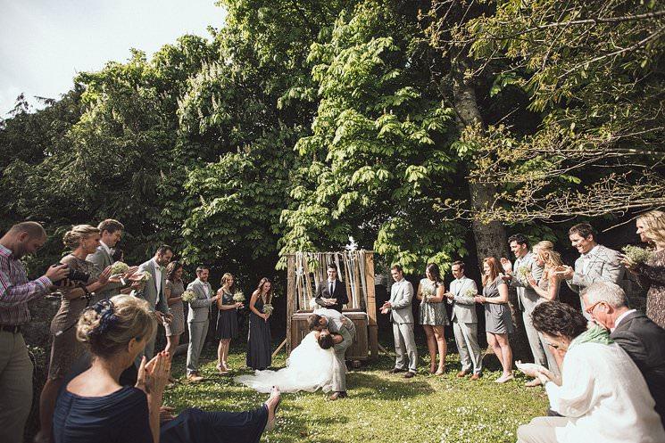 rustic farmhouse wedding - kiss the bride